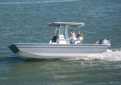3 people slowly cruising on a FlatBottom2260FS