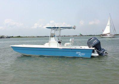 blue bay rider faltbottom anchored near the shore