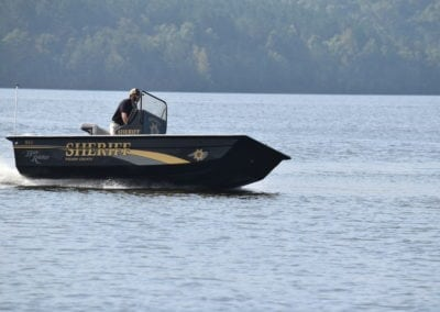 man cruising on a sheriff boat