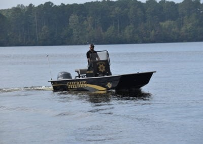 man driving a sheriff boat