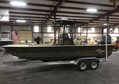 custom green law enforcement boat side view