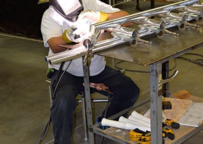 man welding 2 pipes
