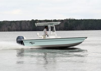 side view of a teal bayrider flatbottom on the water