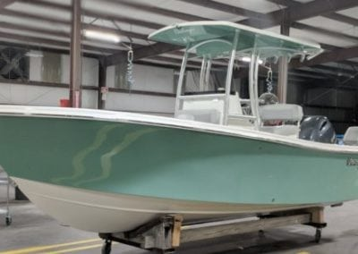 side view of a green challenger boat