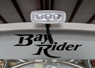 bay rider logo with headlights above it
